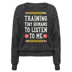 """This teachers design features the text """"Training Tiny Humans To Listen To Me"""" because most early childhood educators know that's half the battle. Perfect for a preschool teacher, teachers, gifts for teachers, teacher humor, and teacher quotes!"""