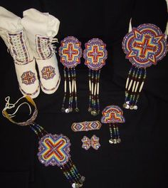 Ladies traditional southern style beadwork set complete with leggings, choker, slave bracelet, hair ties, necklace and purse all made with 9/0 tri cut glass beads. www.sharpsindianstore.com