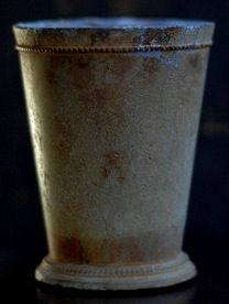 In the 1500s, lead cups were commonly used to drink ale (beer) or whiskey. The combo of lead with heavy amounts of alcohol would sometimes knock the drinker unconscious for several days. These people would be found by strangers, friends, or family members and assumed dead, where they would then be prepared for burial. The person, presumed dead, would be laid out on the kitchen table for a couple of days, while the family would gather around & eat and drink and wait to see if he/she would wake up