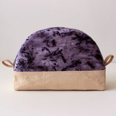 This lovely pouch is made with naturally dyed, organic cotton fabrics, dyed in our home studio. We use logwood chips and a bundle dye technique to create to purple. The beige base fabric was dyed with walnut leaves from Kristina's parents' 50 year old walnut tree.This is an excellent size for makeup or cosmetics as well as the perfect size for small knitting projects like socks or a hat. Lined with natural, unbleached cotton fabric.Measurements: 7in long at base,...