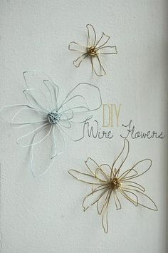 make these to put on tips of real , painted on wall  or canvas branch to use as necklace braclet holders, maybe could add some aluminum flowers with holes punched (filed down so not sharp of course) for earrings etc?   DIY Wire Flowers - Fine and Feathered