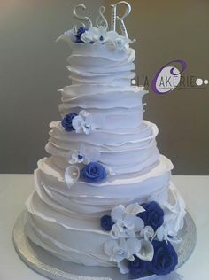 Ruffles Wedding Cake with purple roses and calla lilies