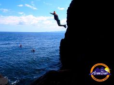 Coasteering in Azores, Portugal   The coasteering is a relatively new sport that consists of progress along the coast and the rocks by the sea, using swimming, climbing, jumping and walking.