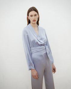 Buttery soft ice blue satin makes for the perfect body of a timeless top. The Salome shirt offers multiple wears courtesy of the classic Nanushka tie-knot, which gives the shirt a classic attitude. Wrap Blouse, Blue Satin, Tie Knots, Perfect Body, Body Measurements, Street Style, Celebrities, Spring, Coat