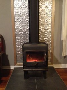 "Ben has used a few sheets of pressed metal to install behind his wood heater. He has used the ""Original"" design for this project. I would want it more antiqued looking but I like the idea Wood Stove Wall, Wood Stove Surround, Wood Stove Hearth, Stove Fireplace, Fireplace Design, Fireplace Wall, Fireplace Ideas, Cabana, Tin Tiles"