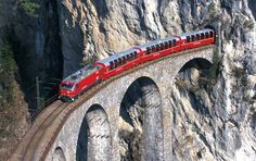 The Bernina Express trains cross the Swiss Alps twice in Graubünden on the UNESCO-listed Albula and Bernina railway lines with 55 tunnels and 196 bridges. Places In Europe, Places To See, Trekking, Trains, Rail Europe, Bernina Express, Scenic Train Rides, Europe Train, Swiss Travel