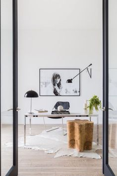 Home Tour: Clean and Minimal In Virginia | The Zhush hyde rug in modern home office with black and white art photography