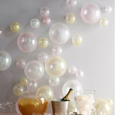 Blow up balloons to different sizes and tape to the wall for an easy yet effective party decoration!