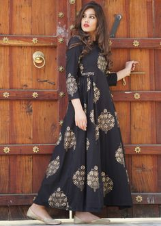 Readymade quarter sleeved black Indo Western maxi dress in cotton with side pleated skirt and all over printed gold motifs. Do Note: All Accessories shown are for styling purpose only. Slight color variation may occur due to photographic reasons. Western Dresses For Women, Frock For Women, Western Outfits, Frock Fashion, Indian Fashion Dresses, Women's Fashion, Fashion Outfits, Ladies Fashion, Skirt Fashion