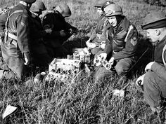 Sergeant V.D. Miller of the 1st Rocket Battery, Royal Canadian Artillery (R.C.A.), holds three different sizes of spoilers used to regulate the speed of rockets fired from the Landmattress rocket launcher during firing trials near Helchteren, Belgium, 29 October 1944. Library and Archives Canada MIKAN 3601147