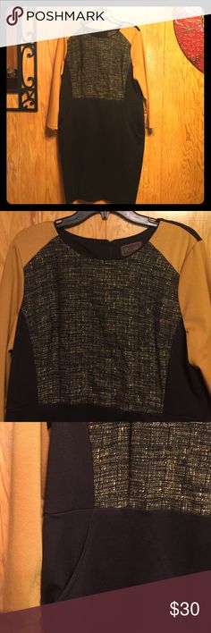 Perfect dress for the fall! 🍁🍂 Long sleeve dress. Color block: black and mustard yellow. Cool pattern on the front. Dress has pockets, perfect to carry cellphone or lipstick! Ask away! Trulli Dresses Long Sleeve