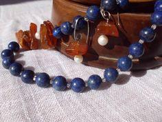 Lapis lazuli, amber, pearls 75€ More on http://nakitkamala.wix.com/europe