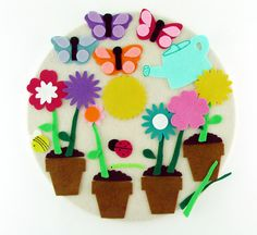 *Please note: The white hoop shown in this listing is a photo prop only, and is not included with your item. WHAT IS THIS ADORABLE FELT TOY?! Felt Flower toy for Kids--a make-your-own quiet activity for children! This fuzzy felt set of flowers, pots and bugs is made of richly