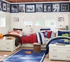 Large White Blue Red Boys Bedroom Design For Three Brothers With Blue Carpet In The Middle And Photo Frame At Top Of Walls Around