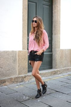 striped shirt and black shorts with booties