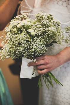 Baby's breath bouquet with character.  For summer add daisies and queen Anne's lace to add even more beauty.