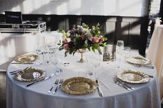 Industrial Meets Floral in New York | Brooklyn, NY | compote centerpiece and gold chargers