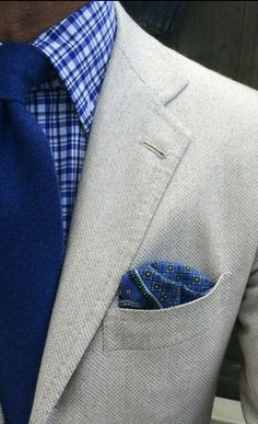 Blue squared shirt, solid blue tie, brown top