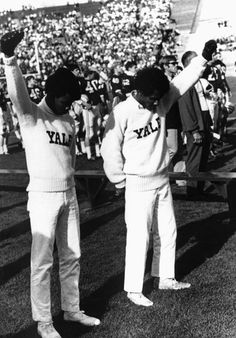 Two weeks after John Carlos and Tommie Smith's iconic medal stand demonstration at the Summer Olympics in Mexico City, Yale cheerleaders Greg Parker and Bill Brown give Black Power salutes during the National Anthem before a game against Dartmouth. History Of Cheerleading, Cheerleading Pictures, History Timeline, History Facts, Black Power Salute, Tommie Smith, Activist Art, Miracle On 34th Street