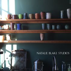 Collection of ceramic cups for the kitchen shelves . . .