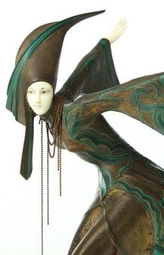 sculpture, Austria, A cold painted bronze sculpture after Gerda Iro Gerdago (Austrian, born 1906), Art Deco dancing woman with ivory head and hands on an onyx base. Signed on skirt.