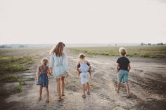 Courtney Adamo and her kids walking on the beach