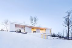 Nook Residence is a minimal white home located in Masonville, Canada, designed by MU Architecture