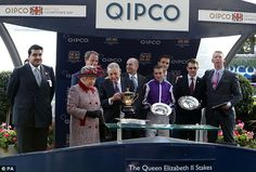 Queen Elizabeth II presents the trophy to the winning trainer of Minding Aidan O'Brien (second right) after the Queen Elizabeth II Stakes