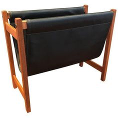Danish Modern Teak & Vinyl Magazine Rack (4,100 PHP) ❤ liked on Polyvore featuring home, home decor, small item storage, magazine racks, teak magazine rack, vinyl home decor, black magazine holder, black magazine file and black home decor