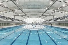 Completed in 2011 in Shanghai, China. Images by Marcus Bredt. The Shanghai Oriental Sports Center (SOSC) just celebrated its opening for the FINA World Swimming Championships from to July