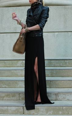 Black leather Jacket with dark grey scarf, paired with a thick double strapped belt w/ silver hardware on a long black skirt with very high sexy side slit, pumps & an oversized handbag