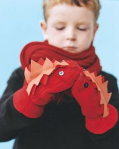 DIY Monster Mittens by marthastewart: Sew the felt features onto premade fleece mittens. Great for hand puppets too!