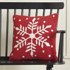 Snowflake Hooked Pillow | A snowflake motif against a bold red background makes this hooked pillow a festive option for the season.