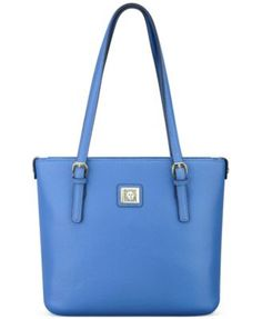 It's business critical to pull your workday look together, and this classic carryall from Anne Klein is the perfect place to start. Crafted in supple, faux leather with elegant handles that sit perfec