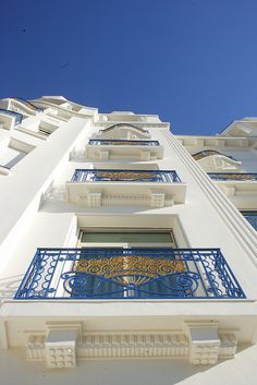 A facade and window picture taken from a bottom angle of the famous Hotel Martinez in Cannes on the french riviera