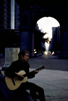Beatnik playing guitar in Washington Square Park, New York City, 1959. Photo by Burt Glinn