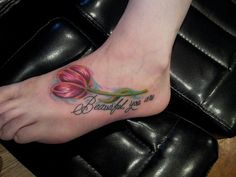 Tulip tattoo on the foot.
