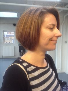 Side view of graduated bob. Hairstyle before cut was shoulder length, with long and short layers. After cut, decided to keep length at the front of the face, blended in layers and took length short, added graduation. Model wanted completely different look. (Sorry forgot too take before picture)