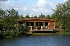 Brompton Lakes is a stunning collection of luxury lakeside bedroom lodges in Yorkshire. Enjoy the unique design of this eco-friendly holiday retreat! Lakeside Lodge, Brompton, North Yorkshire, Cladding, Lodges, Eco Friendly, Cabin, Luxury, House Styles