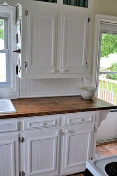 Beadboard wallpaper and trim frames to make over plain-front cabinets and the backsplash <3