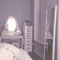vanity, storage shelves next to it