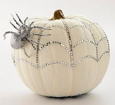 Halloween Decorating with White and Silver. White pumpkin with silver accents and silver spider.