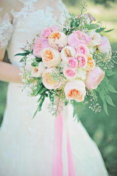 pink and peach bouquet - photo by ArinaB Photography http://ruffledblog.com/soft-and-modern-wedding-inspiration #weddingbouquet #flowers