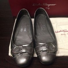 Salvatore Ferragamo Flats 100% authentic. Previously used flats in size 7.  Wore it 5 times or less. Feet grew after pregnancy. Wish they still fit me. With original dust bag and box. Beautiful pewter color with silver metal Ferragamo  buckle. In good condition. Purchase from Ferragamo store. No trade/no exchange / no refund Salvatore Ferragamo Shoes Flats & Loafers