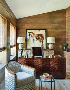 A reclaimed elm chest, a mahogany-burl desk, and mahogany-stained wood paneling imbue the library with masculine appeal. - Photo: Werner Segarra / Design: Suzanne Biers Harrington