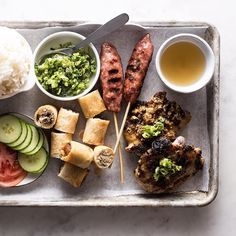 long weekends are perfect for vietnamese feasting: lemongrass chicken, crispy spring rolls, grilled nem nuong (pork), green onion oil, fish sauce, fluffy rice, and the obligatory tomato and cucumber slices Nem Nuong, Fish Sauce, Spring Rolls, Green Onions, Lemon Grass, Long Weekend, Cucumber, Grilling, Pork