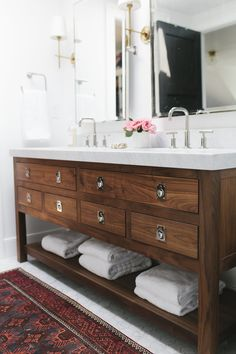 Wood bathroom vanities provide a natural feel and are long-lasting, but can be a bit pricey if you choose to go with solid wood. Make sure any wood vanity Bathroom Vanity Drawers, Hall Bathroom, Upstairs Bathrooms, Wood Vanity, Bathroom Renos, Bathroom Furniture, Bathroom Ideas, Vanity Mirrors, Vanity Cabinet
