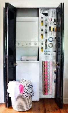 Laundry room with pegboard wall for tools and wrapping supplies.