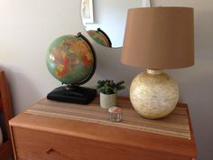 Old Replogle lighted globe with book slot behind base - contains Replogle Comprehensive Atlas of the World 1954