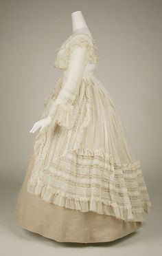 French Dress, late 1860's.  I like the simplicity of the color against the beauty of the lace.